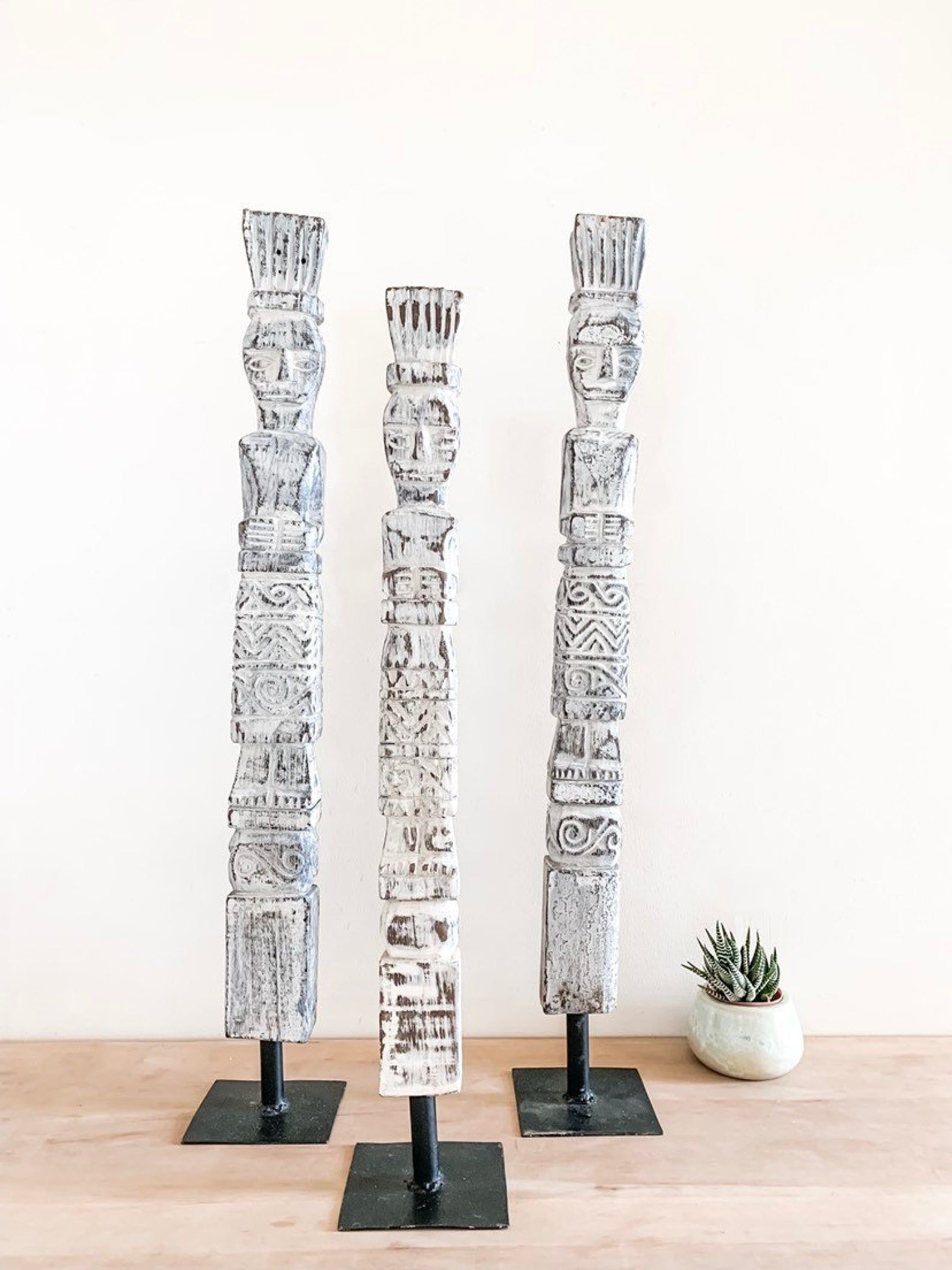 Primitive timber statues from Etsy